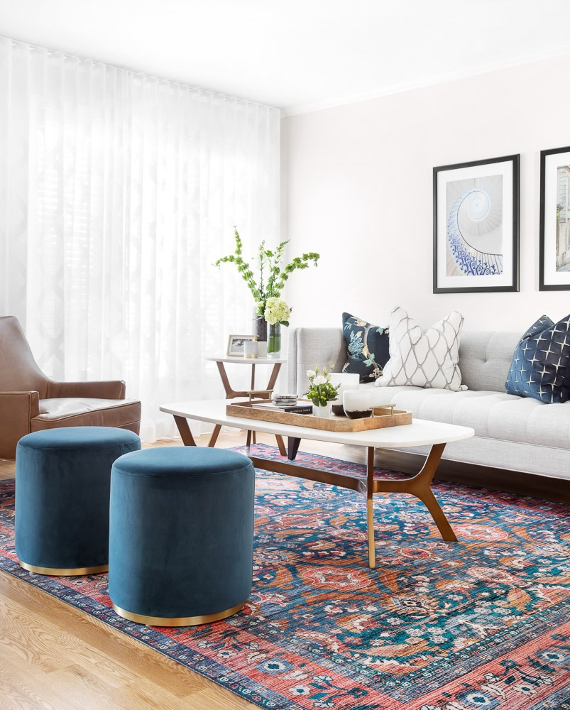 Round blue velvet ottomans/footstools in contemporary living room