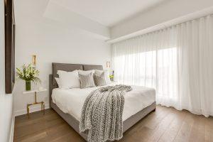 Wide plank floor master bedroom