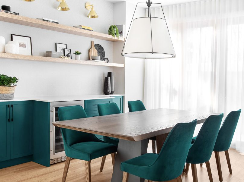 Contemporary kitchen design green cabinets and green chairs